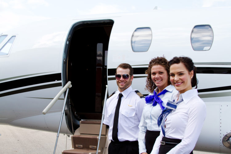 Pilot and stewardesses by plane